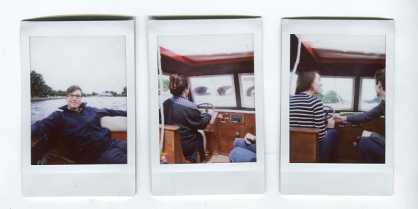 Three polaroids of us on a boat