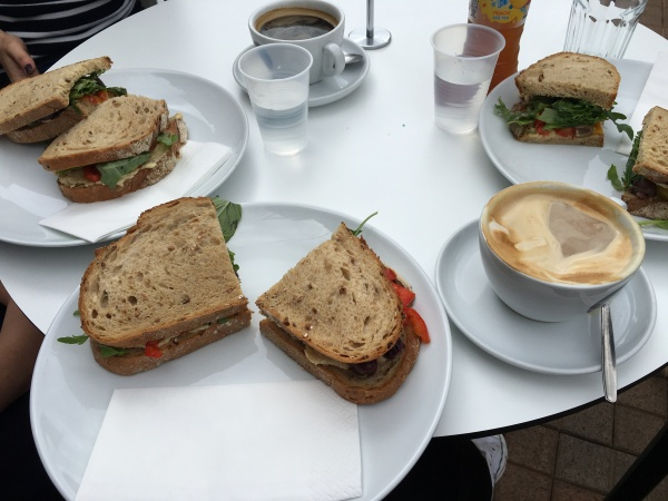 table with sandwiches and coffee on
